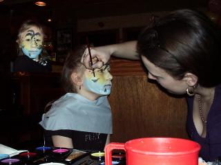 Cara having her face painted