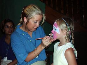 Cara having her face painted.